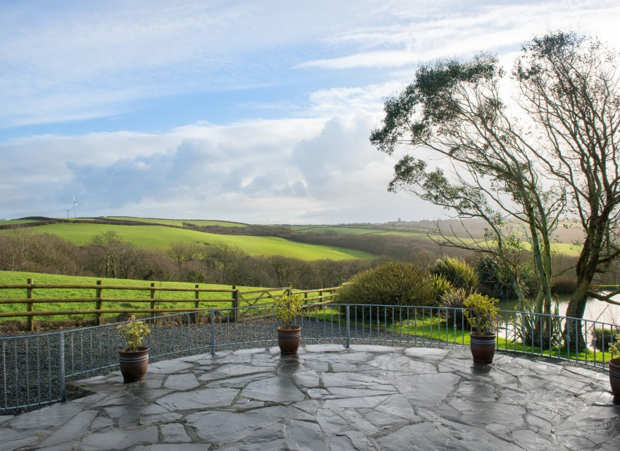 The Stables patio with glorious views - Holiday Cottage with pool in Bude, North Cornwall