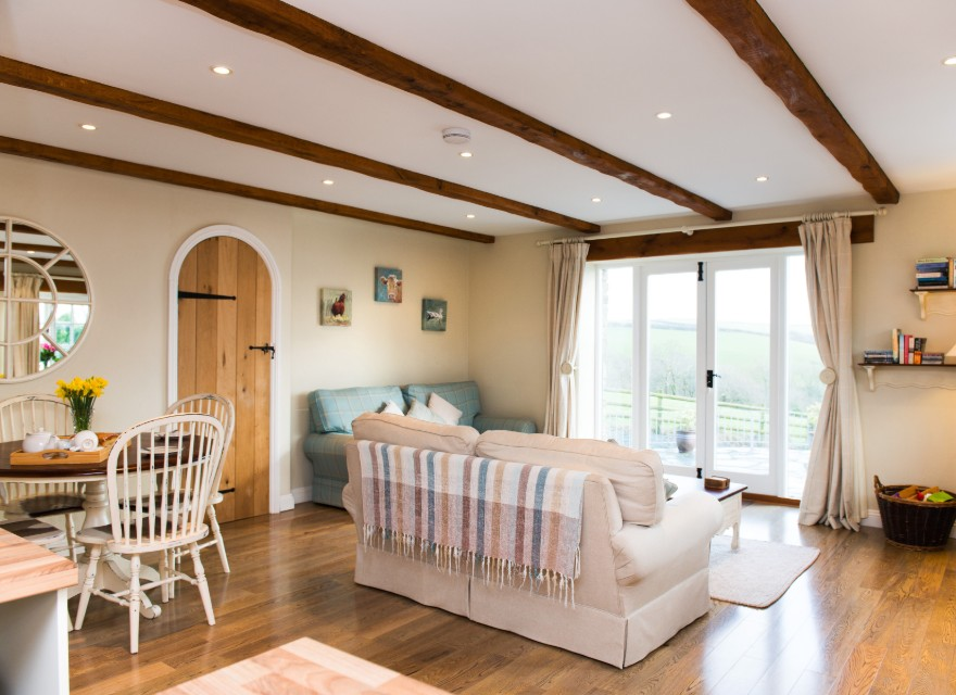 The Stables living room with views - Holiday Cottage with pool in Bude, North Cornwall